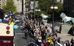 Fans cheer as members of the Chicago Sky ride a bus during a parade down Michigan Ave. near The Art Institute of Chicago celebrating their WNBA basket
