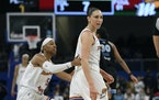 Phoenix Mercury's Diana Taurasi right, is held back by teammate Shey Peddy left, after she wanted a foul to be called against Chicago Sky's Kahlea