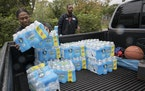 Bottled water is distributed in Benton Harbor, Mich., Oct. 13, 2021. The water problems in Benton Harbor and Flint expose broader failures in the nati