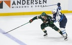 Kirill Kaprizov was hassled by Jets defenseman Josh Morrissey (44) in overtime Tuesday. Morrissey was penalized, and the Wild scored on a power play t