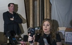 Dawn McClain and Brady Jeunesse, members of the Twin Cities Paranormal Society, in the attic office of the Lexington Restaurant in St. Paul, where the