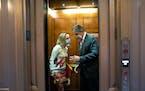 FILE — Sens. Kyrsten Sinema (D-Ariz.) and Joe Manchin (D-W.Va.) on Capitol Hill in Washington.