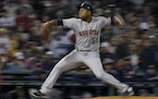 Houston Astros starting pitcher Framber Valdez throws against the Boston Red Sox during the seventh inning in Game 5