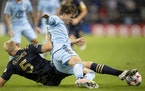 Jakob Glesnes (5) of Philadelpha and Adrien Hunou of the Loons fight for the ball in the first half Wednesday