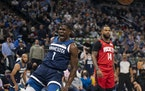 Minnesota Timberwolves guard Anthony Edwards (1) reac ted after he dunked on Houston Rockets center Alperen Sengun in the second quarter Wednesday nig