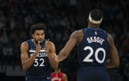 Karl-Anthony Towns (32) pointed to Josh Okogie (20) after he made a defensive play in the fourth quarter Wednesday night.