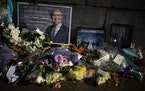 Floral tributes and pictures of British Member of Parliament David Amess lie placed outside the Houses of Parliament in London, Wednesday, Oct. 20, 20
