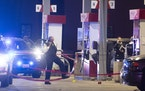 Chicago police officers investigate a shooting incident at a gas station in Lyons, Il., Wednesday, Oct. 20, 2021.
