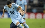 Emanuel Reynoso (10) of Minnesota United FC is slide tackled by Alejandro Bedoya (11) of Philadelphia Union in the first half Wednesday, Oct. 20 at Al