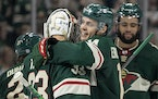 Joel Eriksson Ek and Minnesota Wild goalie Cam Talbot (33) celebrate at the end of the game Tuesday, Oct. 19 at Xcel Energy Center in St. Paul, Minn.