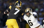 Purdue linebacker Jalen Graham (6) tackled Iowa quarterback Spencer Petras (7) during the second half of the Hawkeyes' 24-7 loss last Saturday.