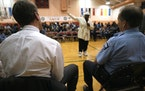 Then-Mayor R.T. Rybak and then-Police Chief Robert Olson at a community meeting on alleged police violence in north Minneapolis in 2003.