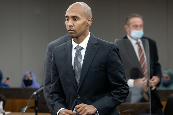 Former police officer Mohamed Noor makes his way to the podium to address Judge Kathryn Quaintance today at the Hennepin County Government Center.