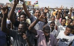 Sudanese demonstrators take to the streets of the capital Khartoum to demand the government's transition to civilian rule in Khartoum, Sudan, Thursd