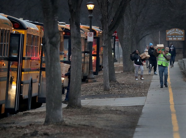 St. Paul school bus drivers and aides headed out with a week's worth of breakfasts and lunches to families of students on March 25, 2020, in St. Pau