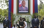 First Lady Martine Moise, center, attends a tribute for her late husband President Jovenel Moise at the National Pantheon Museum in Port-au-Prince Hai