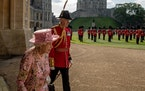 Queen Elizabeth II walks onto the Windsor Castle Quadrangle to wait for President Joe Biden and first lady Jill Biden, in Windsor, England, Sunday, Ju
