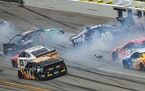 Ross Chastain (42) and Alex Bowman (48) get sideways during a NASCAR Cup series race in Talladega, Ala.