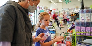 Margot Wanner and her daughter Eliza, 9, checked out toys Thursday to add to a wish list during an afternoon trip to Kiddywampus.