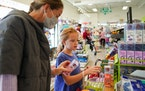 Margot Wanner and her daughter Eliza, 9, check out toys Thursday to add to a wish list during an afternoon trip to Kiddywampus.