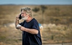 Alec Baldwin speaks on the phone in the parking lot outside the Santa Fe County Sheriff's Office in Santa Fe, N.M., after he was questioned about a