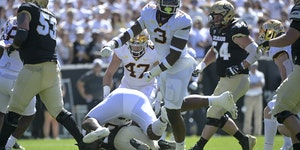 Gophers defensive lineman MJ Anderson (3) celebrated a tackle by teammate Val Martin (56) in the 30-0 victory at Colorado on Sept. 18.