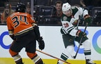 Ryan Hartman of the Wild shot past Jamie Drysdale of the Ducks on Oct. 15 as the teams opened the NHL season in Anaheim.