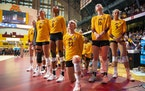 Minnesota middle blocker Katie Myers (23) joined a few other teammates and knelt during the national anthem before their match against Penn State on F