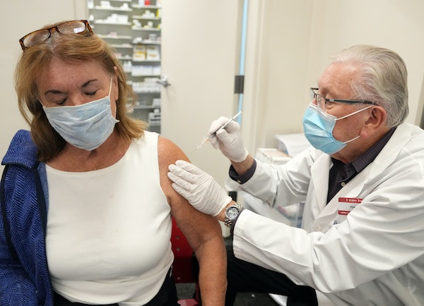 Kay Carlson of Plymouth received her COVID-19 booster shot Friday, Oct. 22, from pharmacist Freeman Mjolsness in Plymouth.