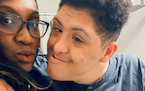 LaToya Lewis and her son, Malik, who is hospitalized with COVID and pneumonia. Malik's developmental disabilities are making it hard for him to tole