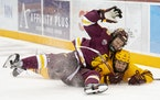 Minnesota Duluth defenseman Hunter Lellig (8) and Minnesota forward Matthew Knies (89) collided during the third period of their game on Friday, Oct.
