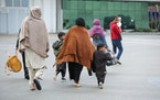 U.S.-affiliated Afghans arrive at the Pristina International Airport in Kosovo on Oct. 16, 2021.