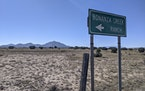 A sign points to the Bonanza Creek Ranch in Santa Fe, New Mexico, on Friday, Oct. 22, 2021.