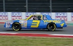 Daniel Ricciardo drives the late NASCAR driver Dale Earnhardt's iconic 1984 No. 3 Wrangler Chevrolet Monte Carlo before an open practice for the For