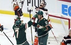 Wild rookie Brandon Duhaime (21) was congratulated by Nico Sturm after Duhaime scored in the first period Saturday night.