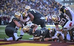 Gophers running back Bryce Williams scores a rushing touchdown during the third quarter