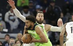 Wolves center Karl-Anthony Towns went up against Pelicans center Jonas Valanciunas on Satruday night at Target Center.