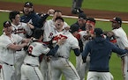 The Atlanta Braves celebrate after winning Game 6 of the National League Championship Series against the Los Angeles Dodgers
