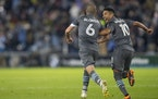 Minnesota United midfielder Emanuel Reynoso celebrates with Ozzie Alonso after Alonso scored the equalizer against Los Angeles FC