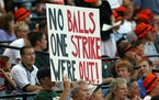A fan holds up a sign commenting on the possibility of another work stoppage in major leaguebaseball, during a game between the Detroit Tigers and t