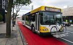 A Metro Transit bus drove north on Hennepin Avenue in a dedicated bus lane toward the Uptown Transit Station. ]  LEILA NAVIDI • leila.navidi@startri