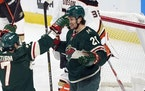 Wild winger Brandon Duhaime (21) was congratulated by teammate Nico Sturm on his somewhat fluky first NHL goal Saturday night against the Ducks.