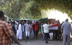 Sudanese protesters take part in the second day of a sit-in to call for the dissolving of the joint military-civilian government, outside the presiden