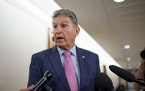 In this Oct. 5, 2021 photo, Sen. Joe Manchin, D-W.Va., talks to reporters as he arrives to chair the Senate Energy and Natural Resources Committee, at