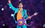 In this Feb. 4, 2007, file photo, Prince performs during the halftime show at the Super Bowl XLI football game in Miami. Minnesota's Congressional d