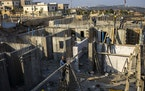 Palestinians built new houses in the West Bank Jewish settlement of Bruchin near the Palestinian town of Nablus, Monday, Oct. 25, 2021. Israel is expe