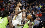 New Orleans Pelicans forward Naji Marshall (8) is called for a charge with defense from Minnesota Timberwolves guard Patrick Beverley, right, in the f