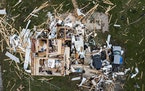 Debris surrounds a wrecked house near Fredericktown, Mo., Monday, Oct. 25, 2021. A tornado swept through the region late Sunday night leveling houses