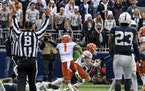 Illinois wide receiver Casey Washington (14) celebrated after a 2-point conversion in the ninth overtime to defeat Penn State 20-18 last Saturday.