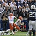 Illinois wide receiver Casey Washington (14) celebrated after a two-point conversion in the ninth overtime to defeat Penn State 20-18 last Saturday.